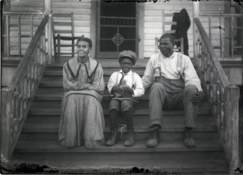 """Shackelford Family on Porch. From exhibition """"Both Sides of the Lens: Photographs by the Shackelford Family, Fayette County, Alabama (1900-1935)."""" Birmingham Alabama Public Library Archives."""