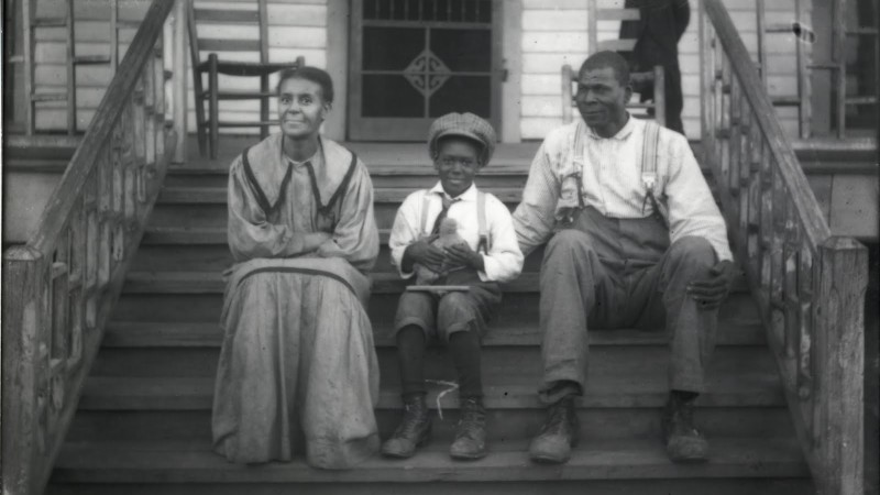 "Shackelford Family on Porch. From exhibition ""Both Sides of the Lens: Photographs by the Shackelford Family, Fayette County, Alabama (1900-1935)."" Birmingham Alabama Public Library Archives."
